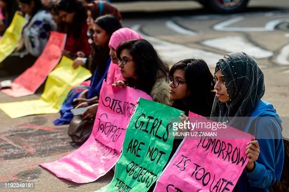 Dhaka University students hold placards as they take part in a rally to demand punishment for the people involved in the rape case of a female student of the university, in Dhaka on January 7, 2020. - The sexual assault of a student at a top university in Bangladesh triggered angry protests in Bangladesh on January 6, with demonstrators urging the death penalty for convicted rapists. (Photo by MUNIR UZ ZAMAN / AFP) (Photo by MUNIR UZ ZAMAN/AFP via Getty Images)